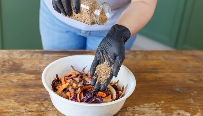 Woman Preparing Her Bokashi Composting Bin